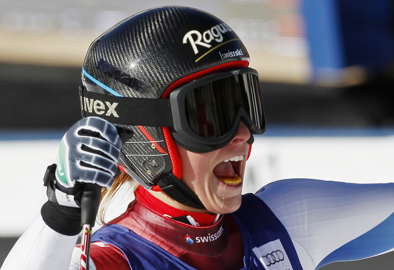 Lara Gut of Switzerland celebrates in the finish area after winning the women's World Cup Super-G ski race in Beaver Creek