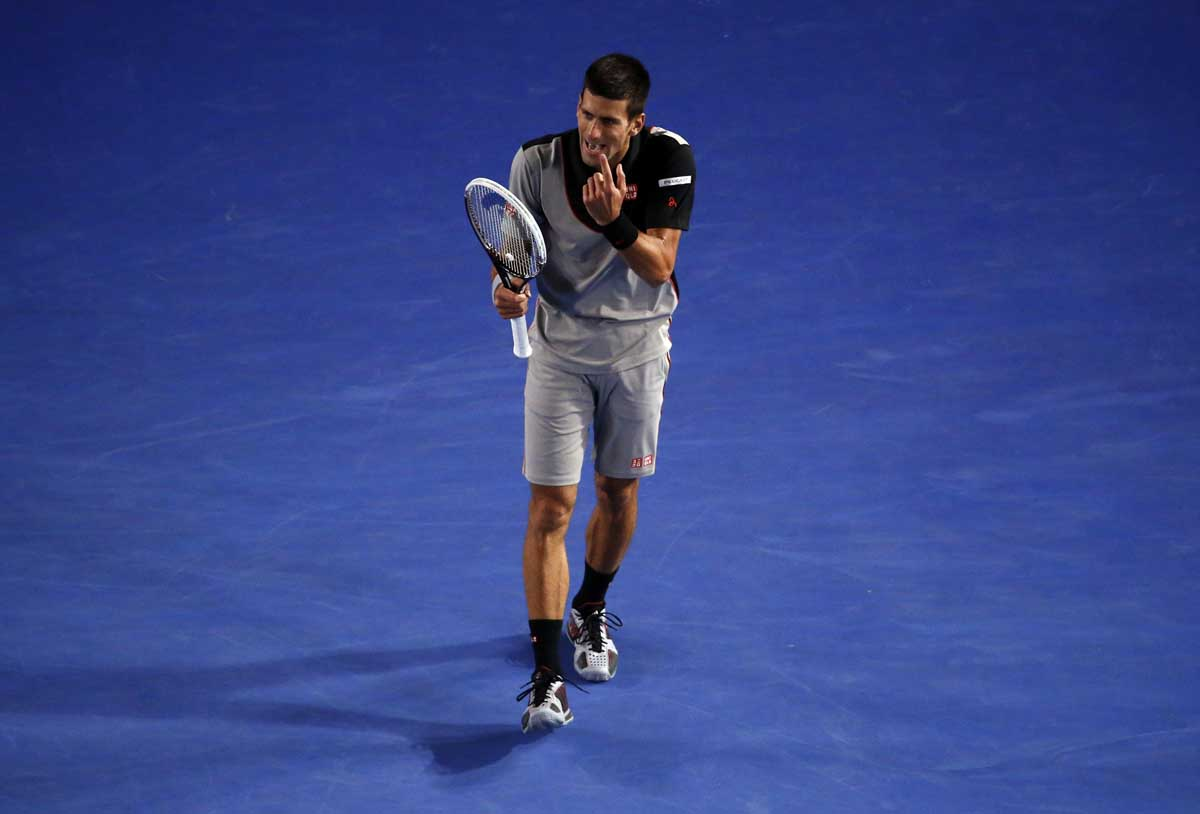 Novak Djokovic of Serbia gestures with one finger during his men's singles quarter-final tennis match against Stanislas Wawrinka of Switzerland at the Australian Open 2014 tennis tournament in Melbourne