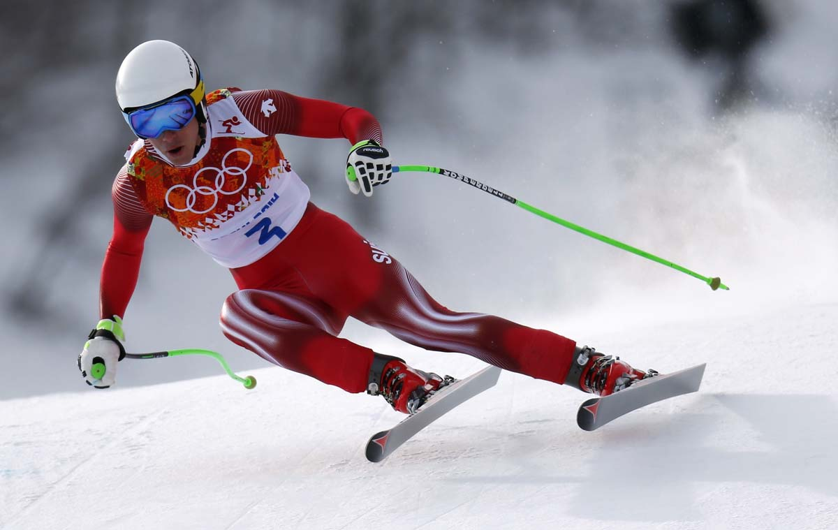 Switzerland's Janka skis in the men's alpine skiing downhill race during the 2014 Sochi Winter Olympics at the Rosa Khutor Alpine Center
