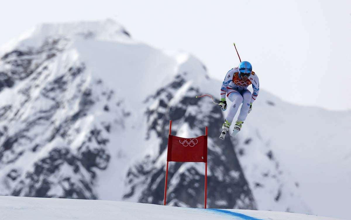 Austria's Mayer goes airborne in the men's alpine skiing downhill race during the 2014 Sochi Winter Olympics at the Rosa Khutor Alpine Center